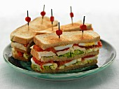 Chicken, tomato, lettuce and hard-boiled egg toasted club sandwiches