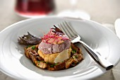 Egg poached in red wine, foie gras and parmesan flakes, potato and pumpkin mash, pan-fried mushrooms and chives