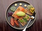 Banka salmon trout, guacamole quenelle, herb vinaigrette, grapefruit segments and seedy crackers