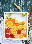 Mixed citrus fruit halves in a dish