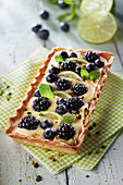 Lemon, blackberry, mint and crushed pistachio rectangular tart