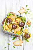 Flower and rabbit-shaped Easter shortbreads and chocolate Easter mini cakes