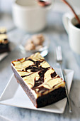 Portion of cheesecake-style brownie and coffee