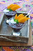 Black rice with coconut milk and fresh mango