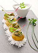 Grenaille potatoes stuffed with oyster and bass tartare