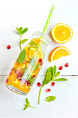 Orange, pomegranate and mint detox water