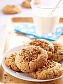 Praline and chocolate chip cookies with a glass of milk