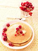 Pancake with brown sugar and raspberries