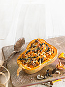 Baked and grilled squash stuffed with mushrooms