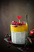 Panacotta chia with mango mousse and pomegranate