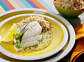 Piece of cod in creamy herb sauce