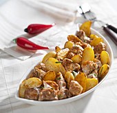Veal and potatoes sauté with yoghurt and chili pepper sauce