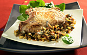 Pork chop with anchovies, pine nuts, mushrooms and baby spinach