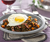 Warm lentil and mustard salad with a fried egg