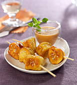 Pike and sesame quenelle brochettes, lobster bisque