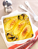 Seafood quenelles au gratin