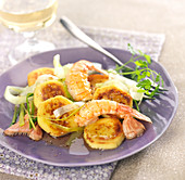 Pan-fried quenelles and langoustines cooked with cider