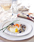 Poached egg with morels and salmon roe