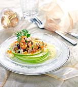 Thin round slices of Granny Smith apples topped with haddock, salmon and herring tartare