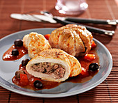 Turkey olives stuffed with ground beef and button mushrooms, tomato and black olive sauce