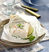 Cod with creamy mint and lime sauce cooked in wax paper