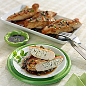 Chicken breasts stuffed with fresh goat's cheese and oregano, white wine, honey and caper sauce