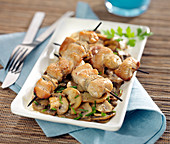 Chicken brochettes with soya, honey thinly sliced mushroom and chive sauce