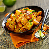 Potatoes sauté with spices and limes
