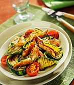 Grilled thinly sliced chicken breast, tomatoes and courgettes