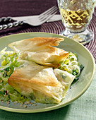Leek, munster and crushed hazelnut filo pastry parcels
