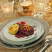 Doe fillet with cranberries, romanesco cabbage flan