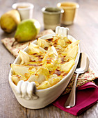 Pear and thinly sliced almond gratin