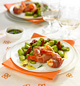 Broad bean and sun-dried tomato salad and shrimps wrapped in ham