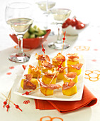 Diced polenta and raw ham appetizers
