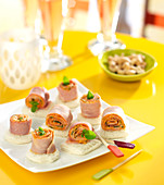 Rolled ham and white bread appetizers