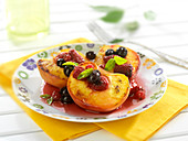 Roasted peaches with summer fruit