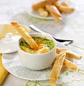 Shirred eggs with herbs and Mimolette, bread fingers