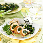 Rolled chicken fillets stuffed with spinach and Comté