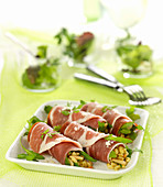 Bayonne raw ham rolls garnished with wheat risotto with rocket lettuce