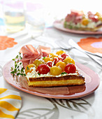 Cherry tomato, petit Billy cheese and raw ham flaky pastry tart
