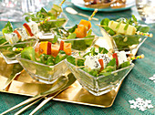 Corn lettuce salad with cheese brochettes