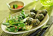 Provençal Caillettes brochettes with sweet peas sauté