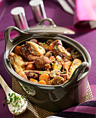 Chicken with red wine and button mushrooms