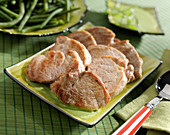 Pork Filet mignon medaillons with herbs and plain green beans