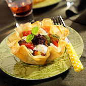 Hake and ratatouille in a filo pastry corolla
