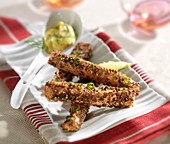 Salmon sticks coated in pepper, dill mayonnaise