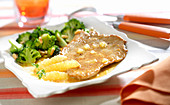 Veal escalope with lemon, broccolis and grilled pine nuts