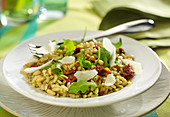 Rice, sun-dried tomatoes, rocket lettuce, pine nut and parmesan flake salad