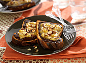 Sliced brioche with melted chocolate, banana puree and hazelnuts
