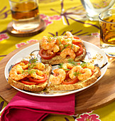 Brown sandwich bread topped with curried shrimps